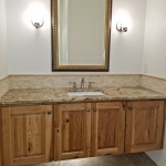 Oversized raised vanity at powder room